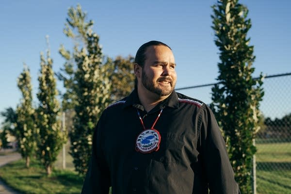 Red Lake Tribal Secretary Sam Strong stands for a portrait.