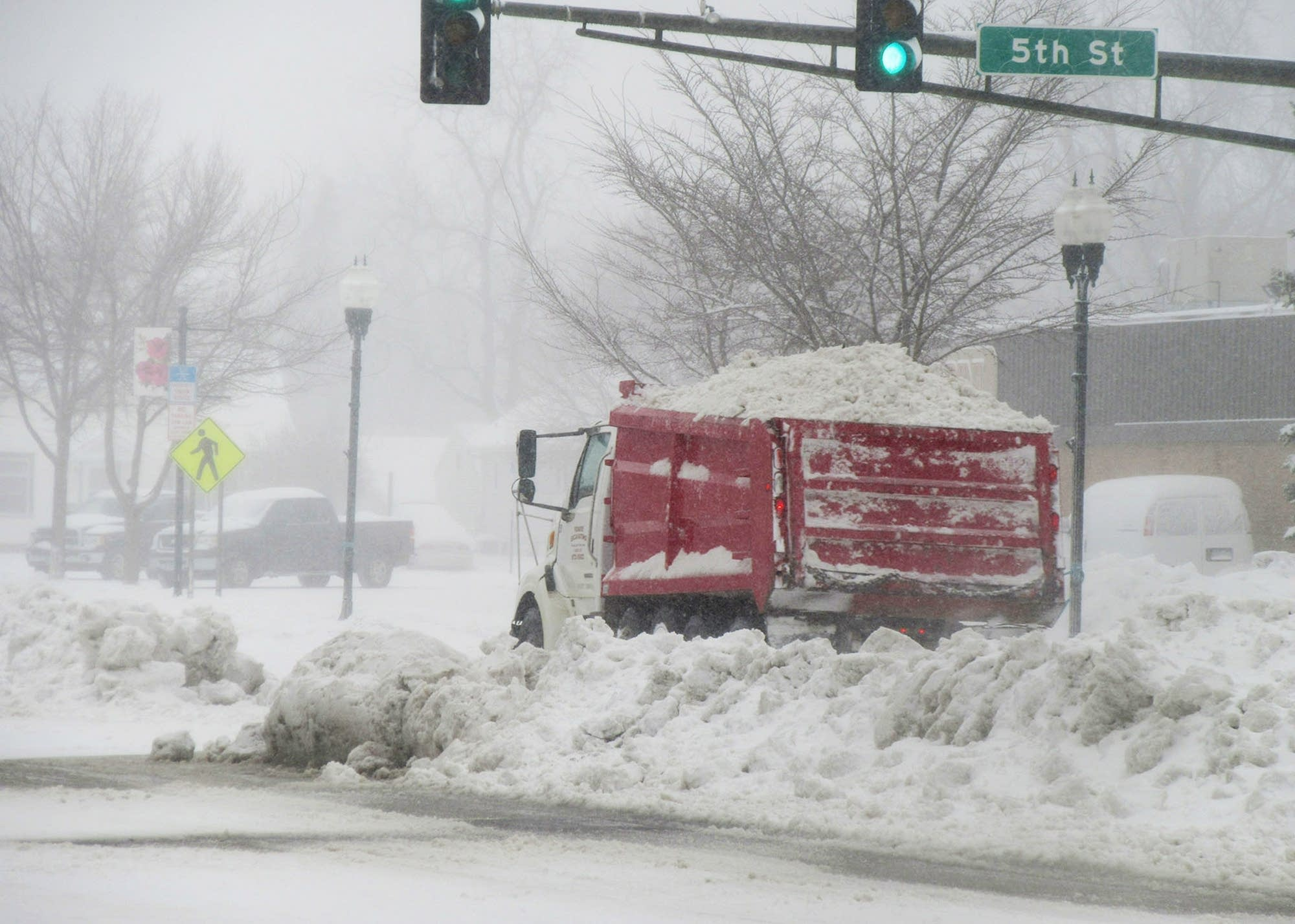 A truck drives in Marshall, Minn., which received about 7 inches of snow.