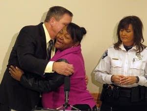 Sa'Lesha Beeks, daughter of Birdell Beeks, embraces Sgt. Chris Thomsen.