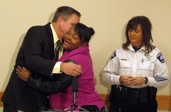 Sa'Lesha Beeks, daughter of Birdell Beeks, embraces Sgt. Chris Thomsen.