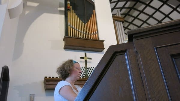 Sarah Carlson plays the new organ at First Lutheran.