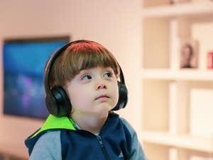 A boy wears headphones.