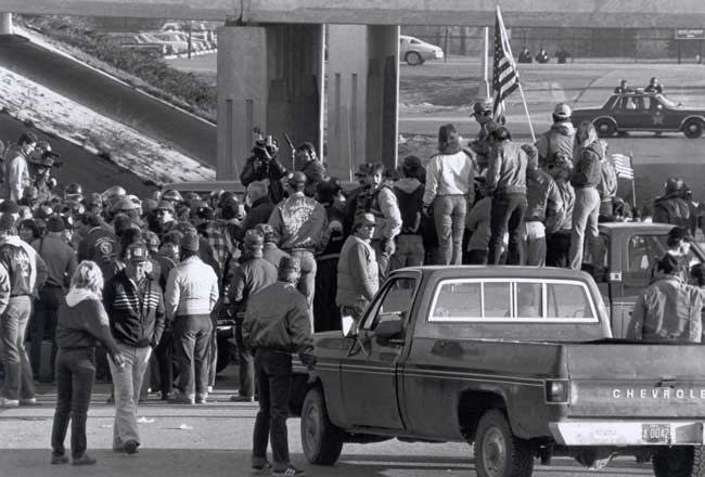 P-9 protest in front of Hormel during 1985 strike