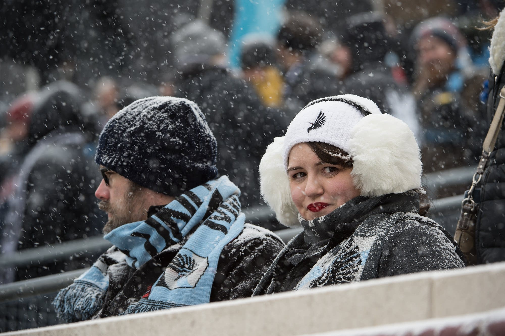 Fans bundled up in Loons gear.