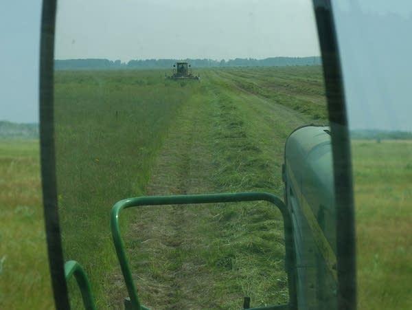 a machine cuts grass in a field
