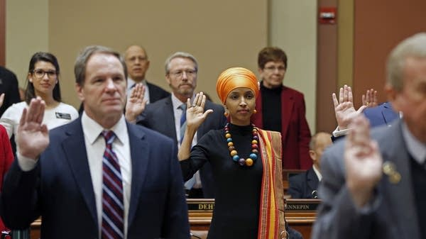 Ilhan Omar takes the oath of office.