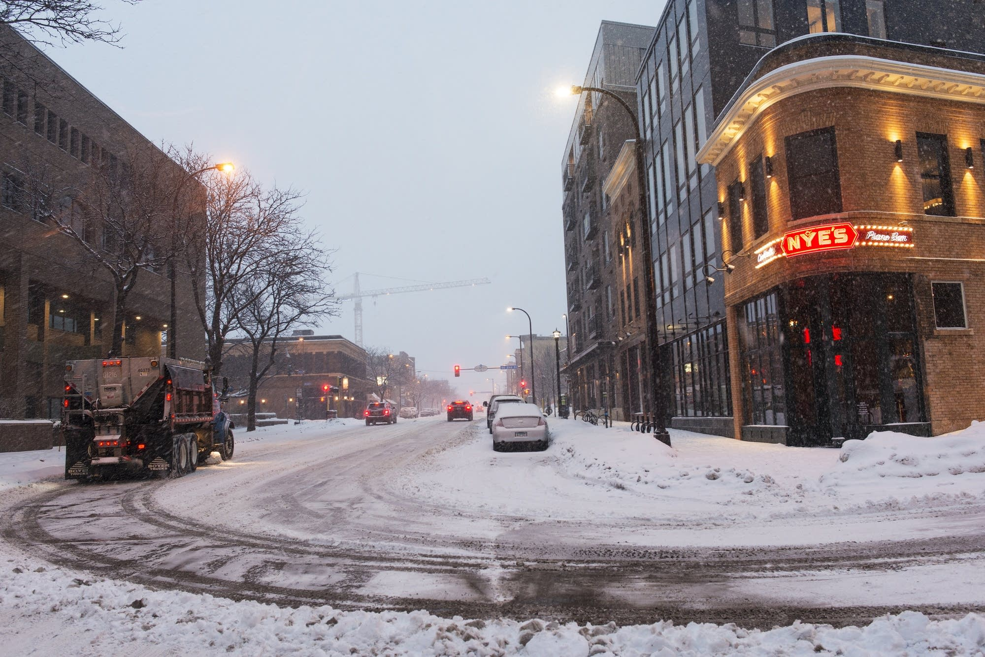 A snowplow clears a path along Hennepin Ave. E.