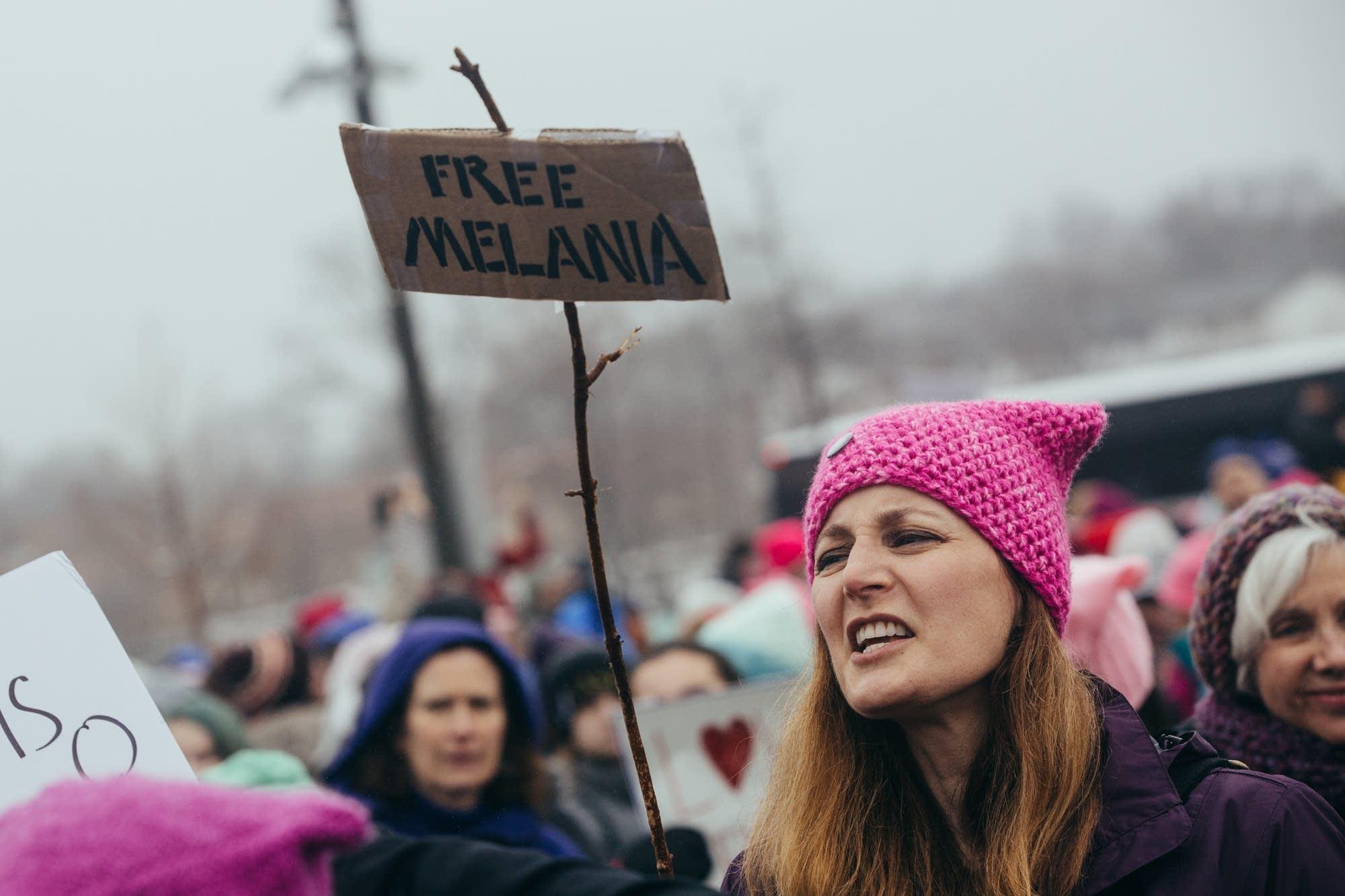 Maureen Rath holds a 'Free Melania' sigh