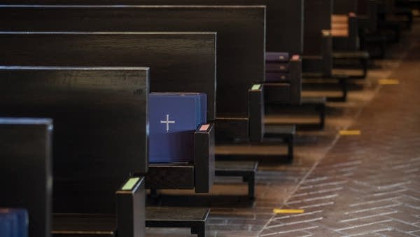 Color-coded pews inside a church.