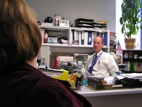 John Bodette in the office