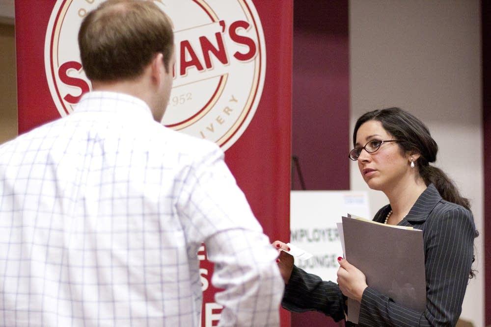 Student talks to a job recruiter