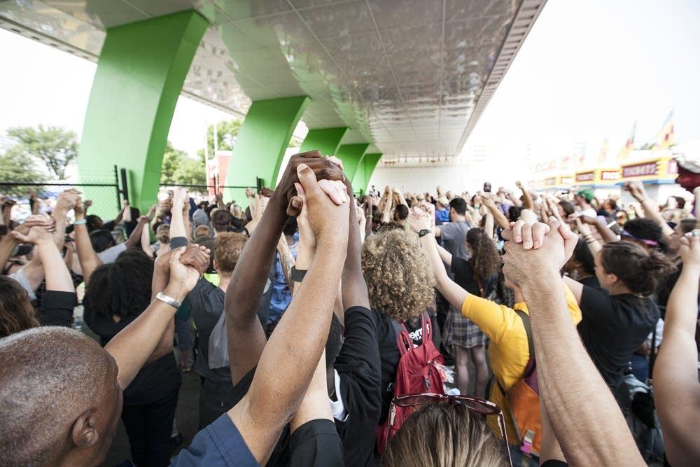Protestors held hands in solidarity before leaving
