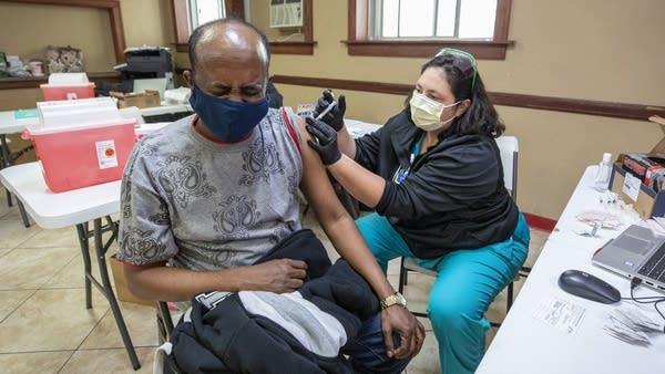 A man receives his COVID-19 vaccine shot.