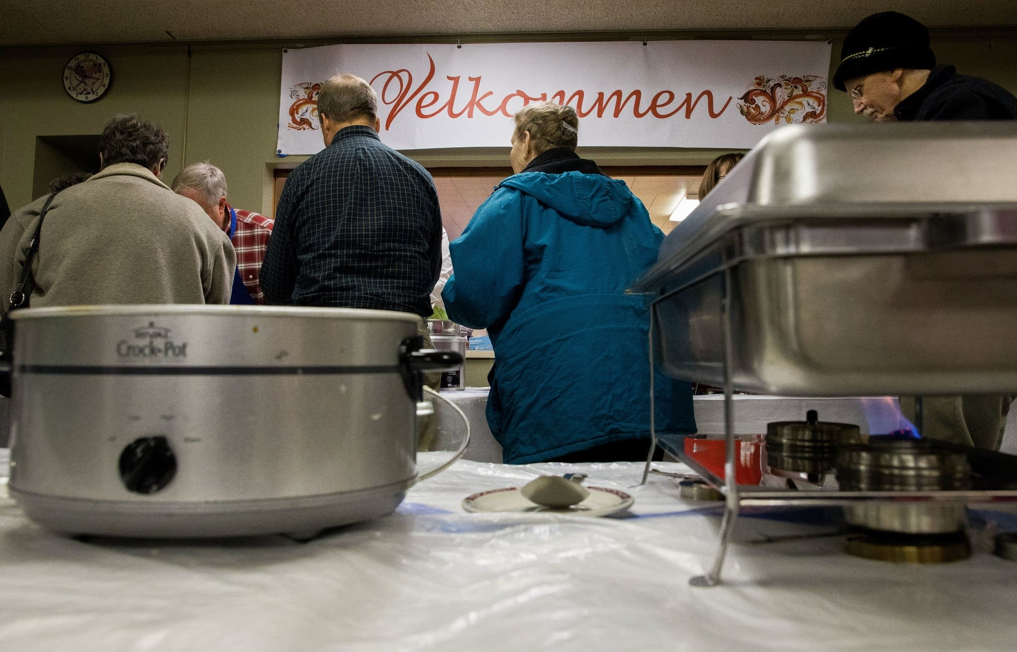 Patrons walk past crock pots and heaters during the First Lutheran dinner.