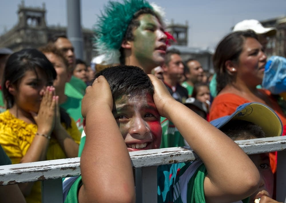 Mexican fans show their dejection