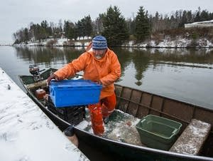 Fisherman Steve Dahl unloads fish.