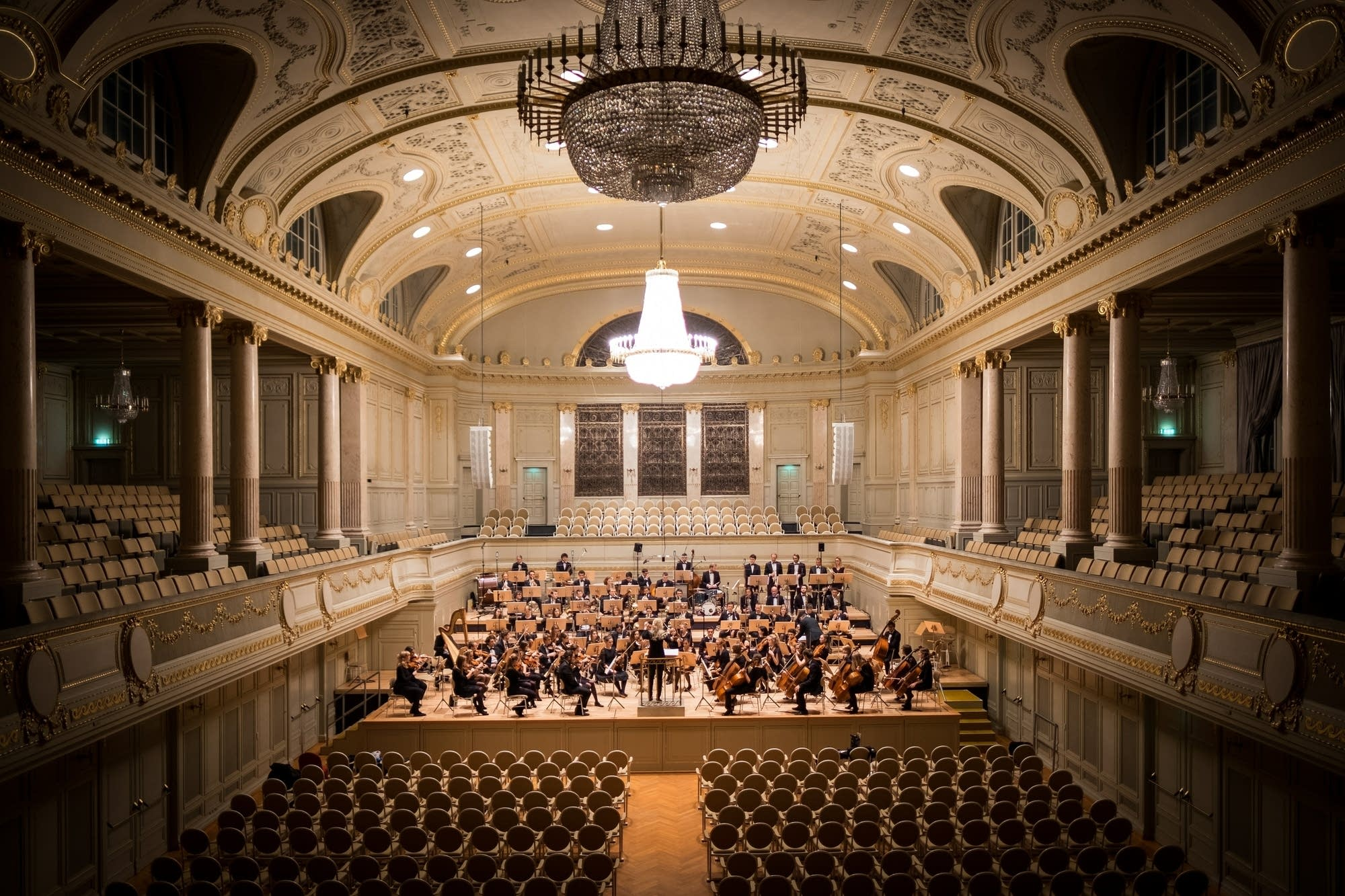 An orchestra hall with empty seats