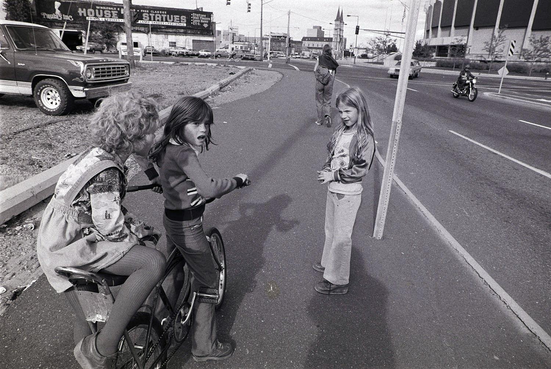 Three girls play on W. 7th Street, near the St. Paul Civic Center.