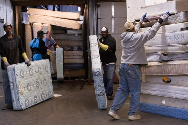 Second Chance Recycling receiving mattresses.