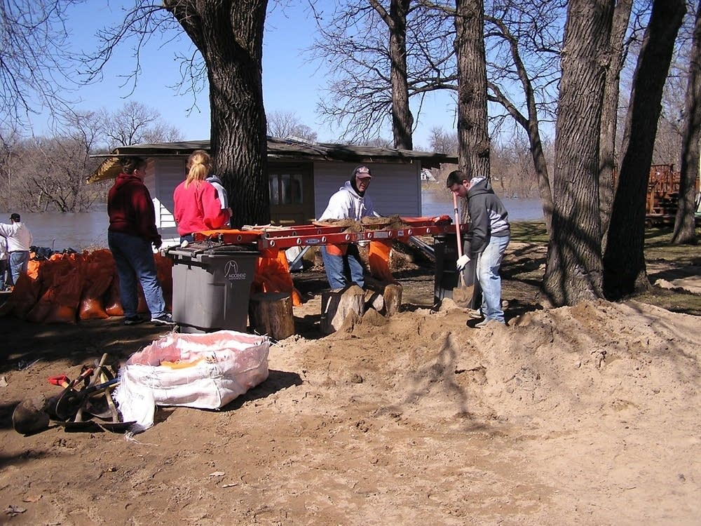 Volunteers fill sandbags