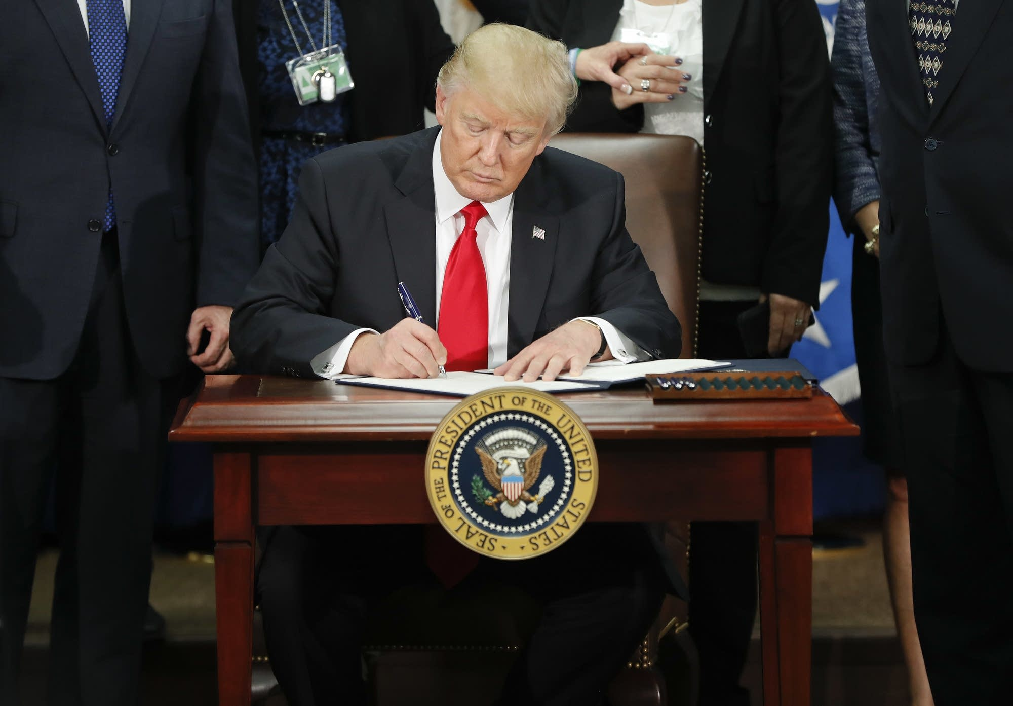 President Donald Trump signs an executive order