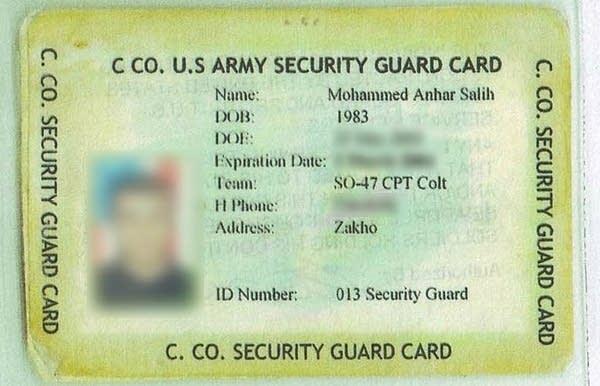 Salih's identification badge