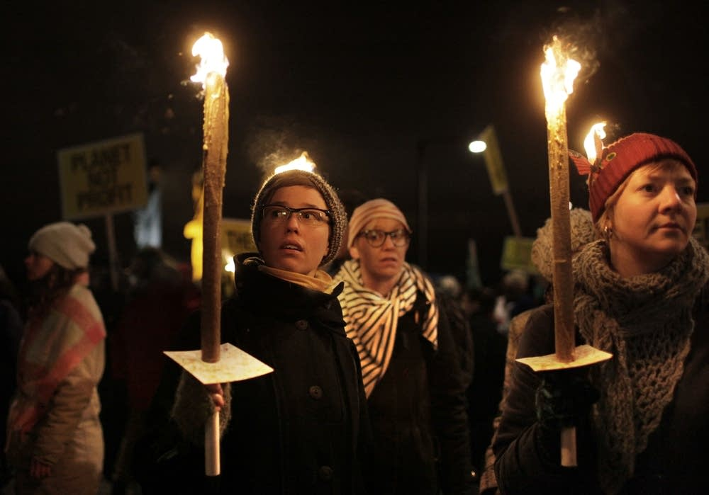 Protesters cary torches