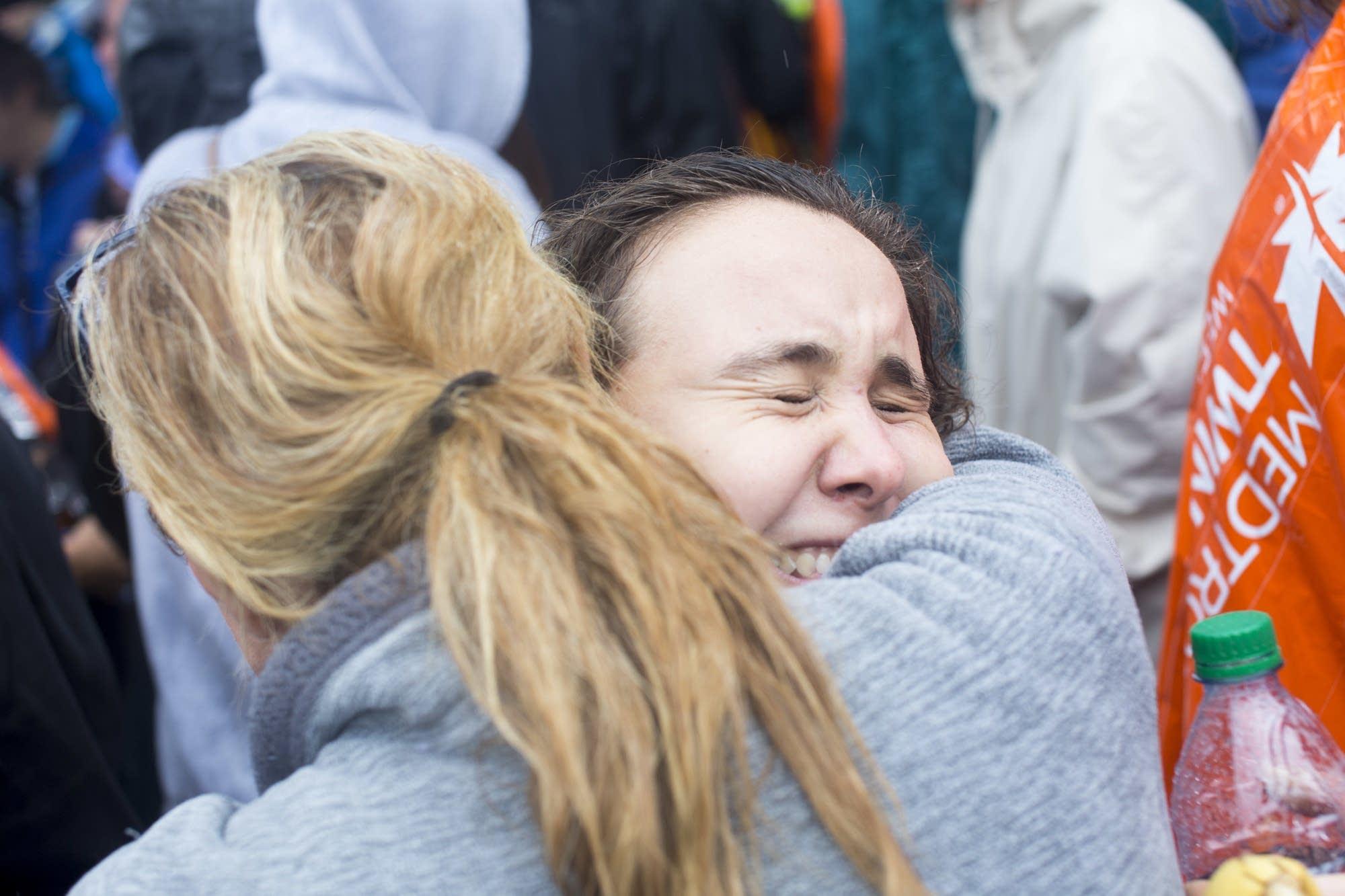 Rachel Hastings hugs her mother after the race.