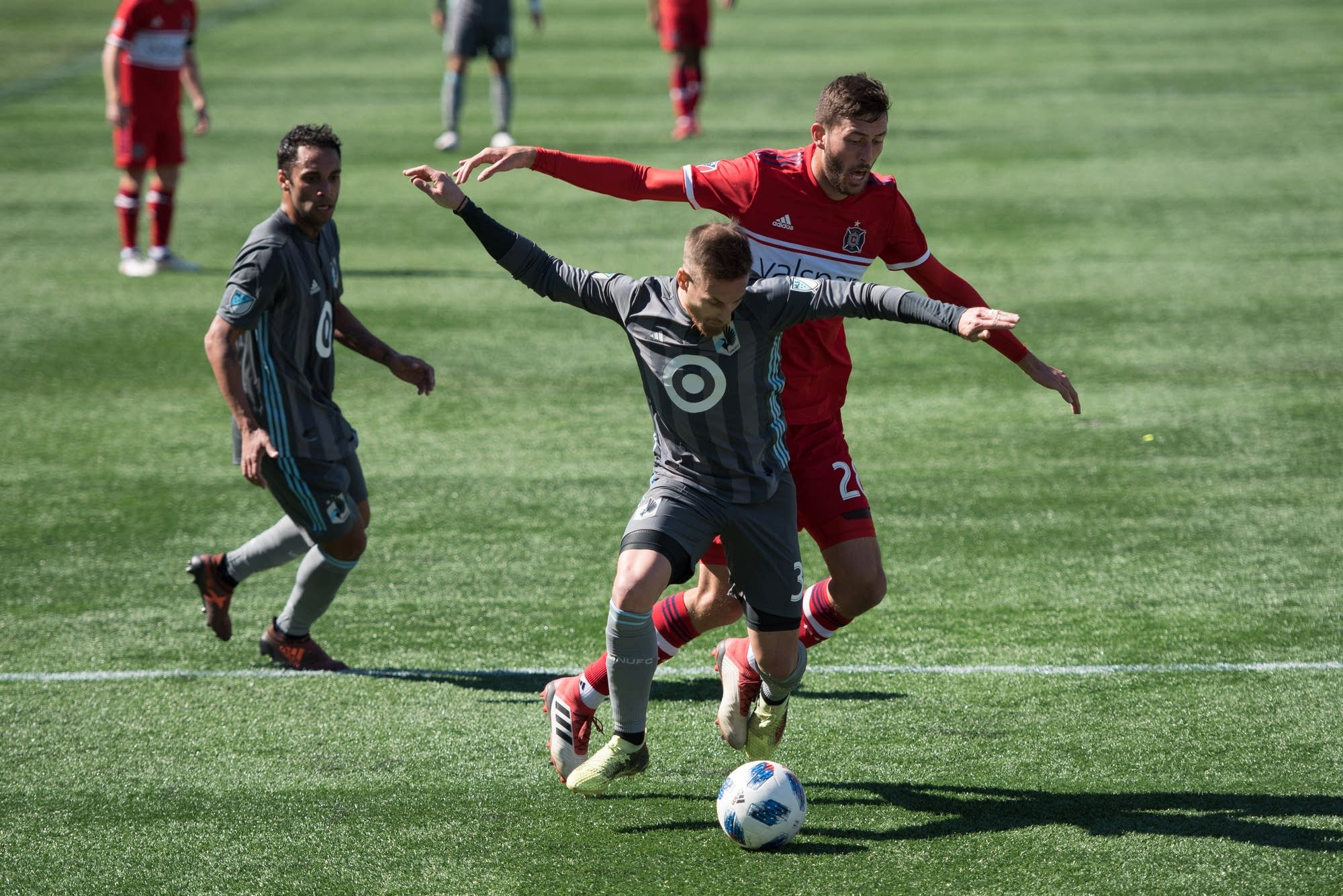 Jerome Thiesson (3) battles Chicago's Elliot Collier (28) for the ball.