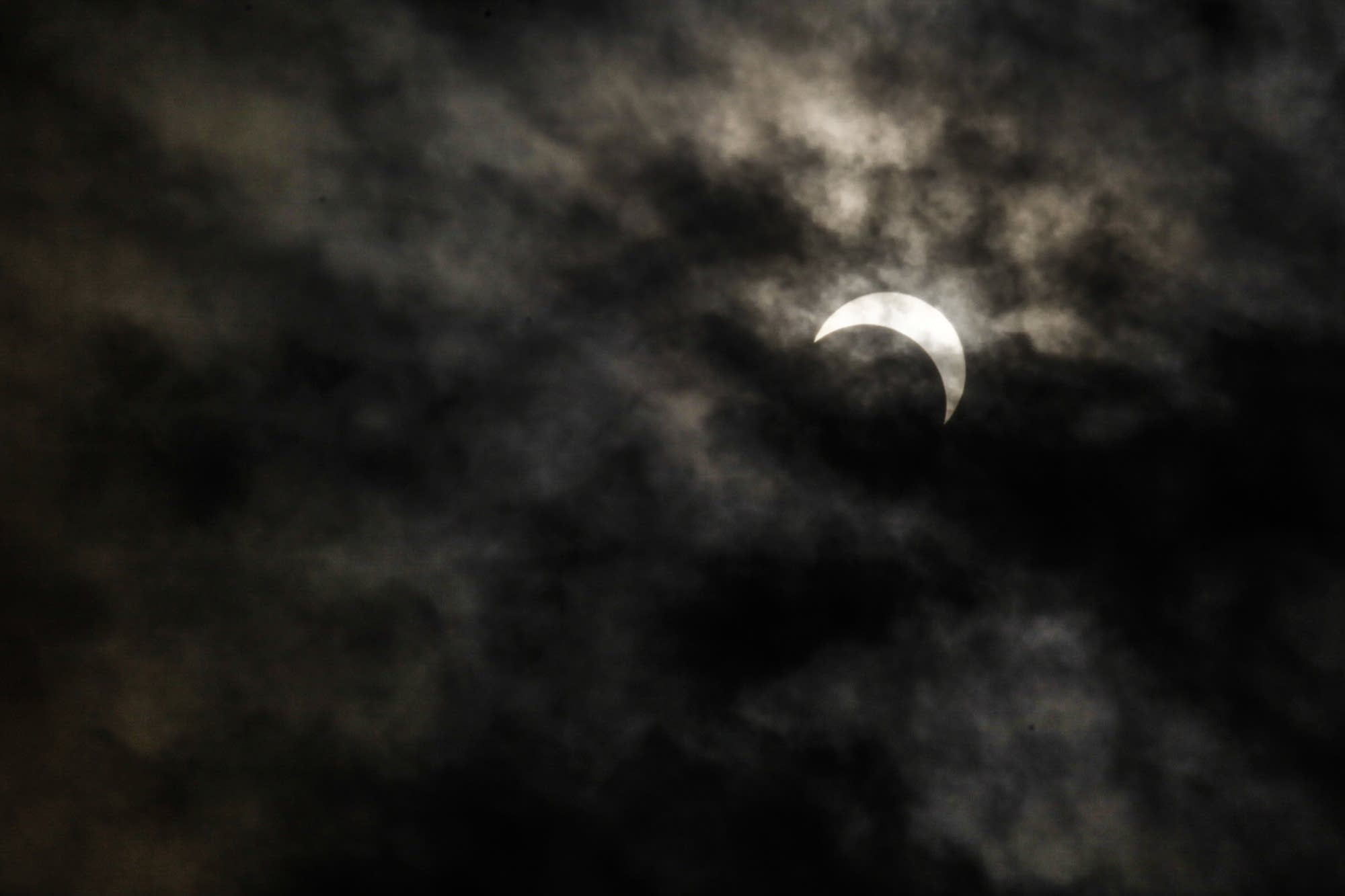 The last bit of the eclipse was in view in St. Paul, Minn.