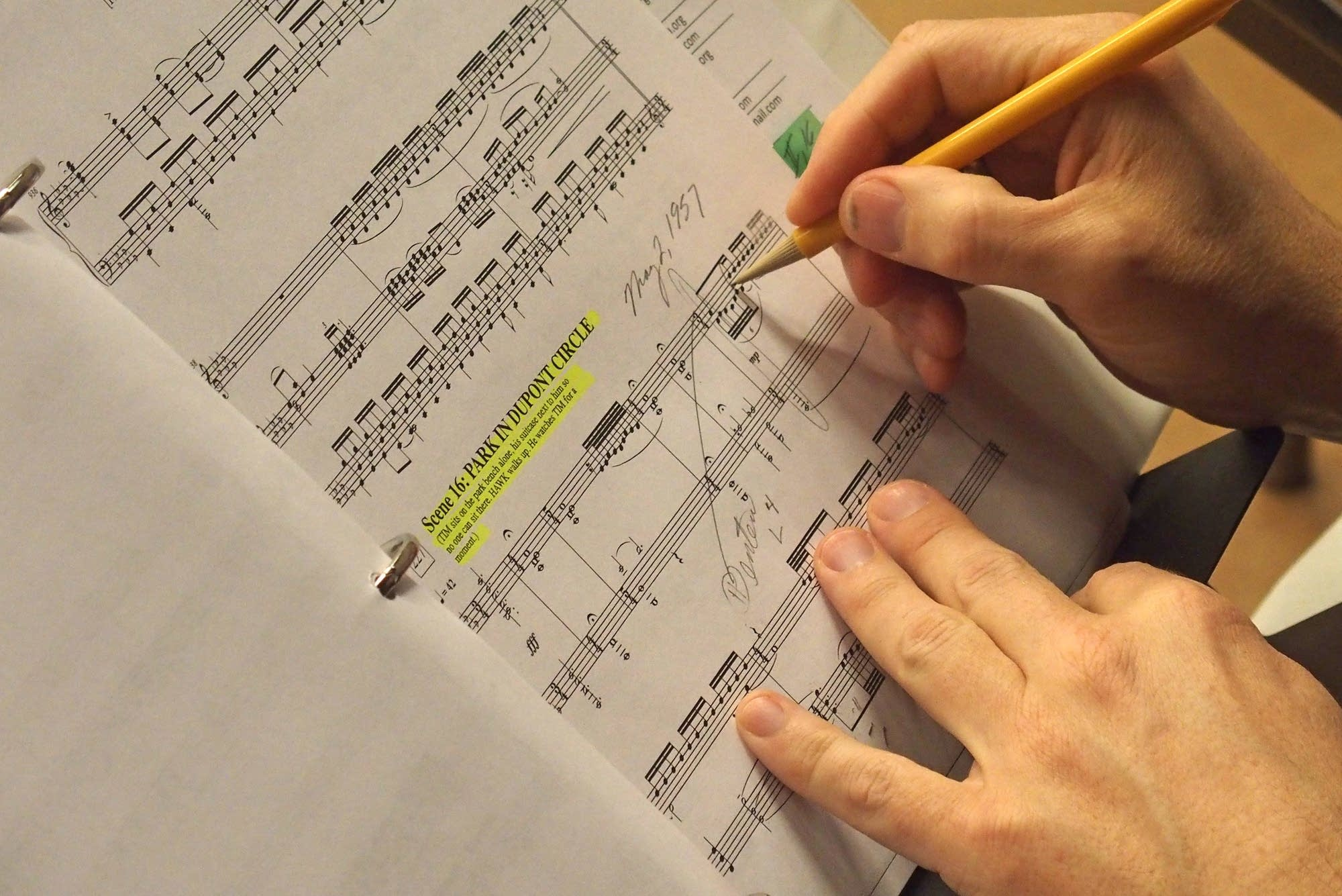 Peter Rothstein makes notes on his rehearsal score.