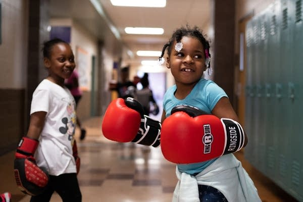 Seven-year-old Aaliyah trains in the hallway after school.