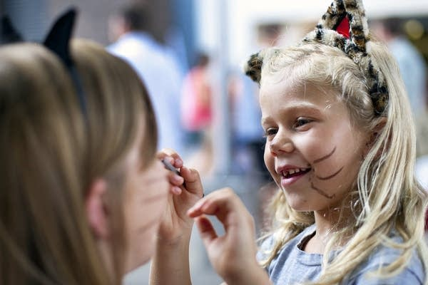Megan Leschinsky, 7, draws whiskers