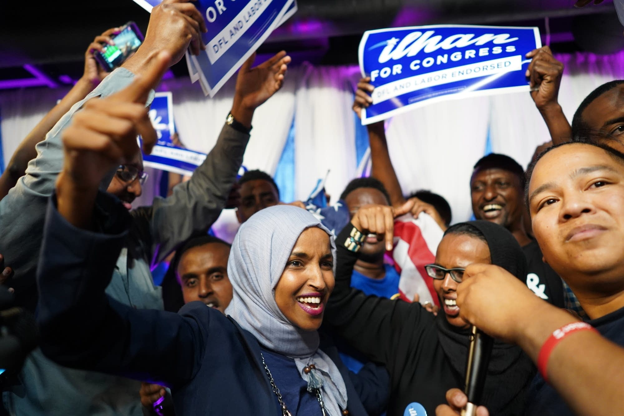 Minnesota Rep. Ilhan Omar, center, celebrates with her supporters.