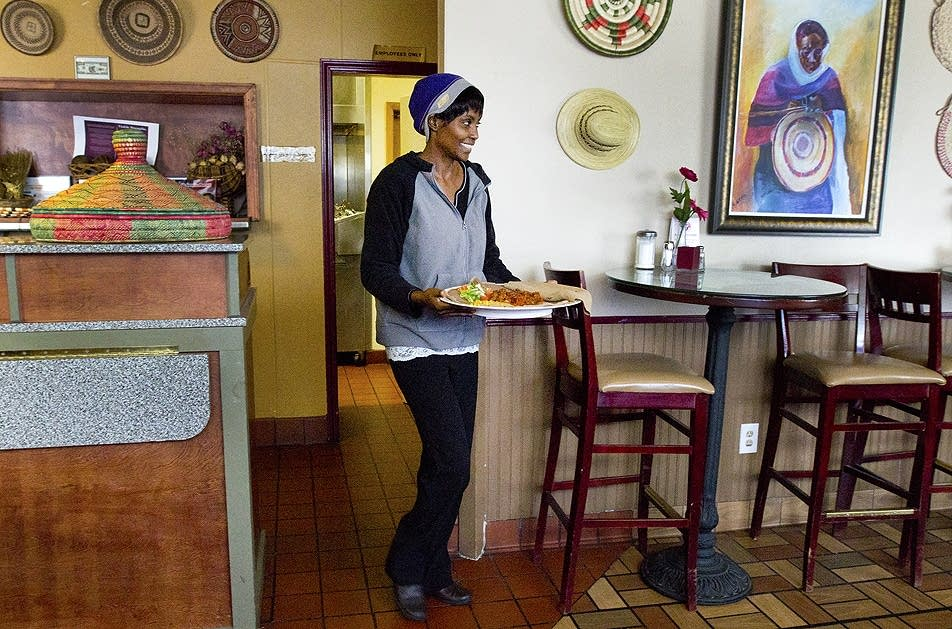 Shege Kebede carries out a lunch order