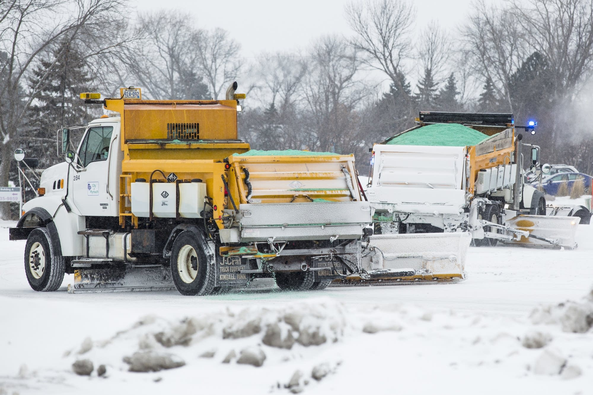 Two plow trucks take to the streets in Plymouth.