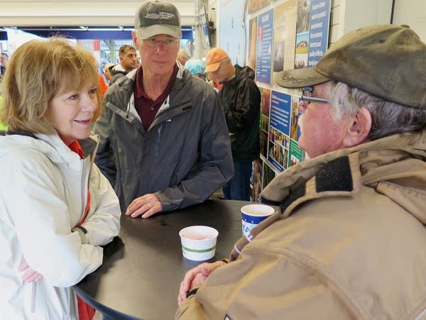 U.S. Senator Tina Smith talks with farmer Jerry Jensen.