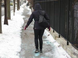 Justyna Sparrow negotiates an icy Ramsey Hill sidewalk.