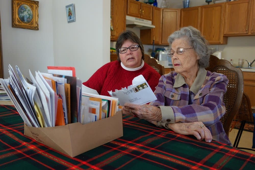 Yvonne and Jody looking at mail