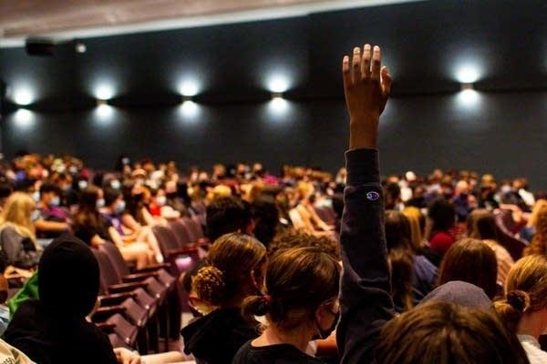 A student raises their hand.
