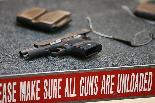 Firearms Enthusiasts Practice Shooting At Gun Rang