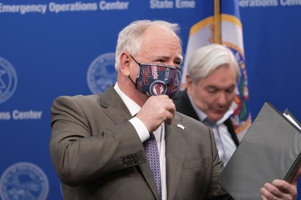 Gov. Tim Walz wears a mask.