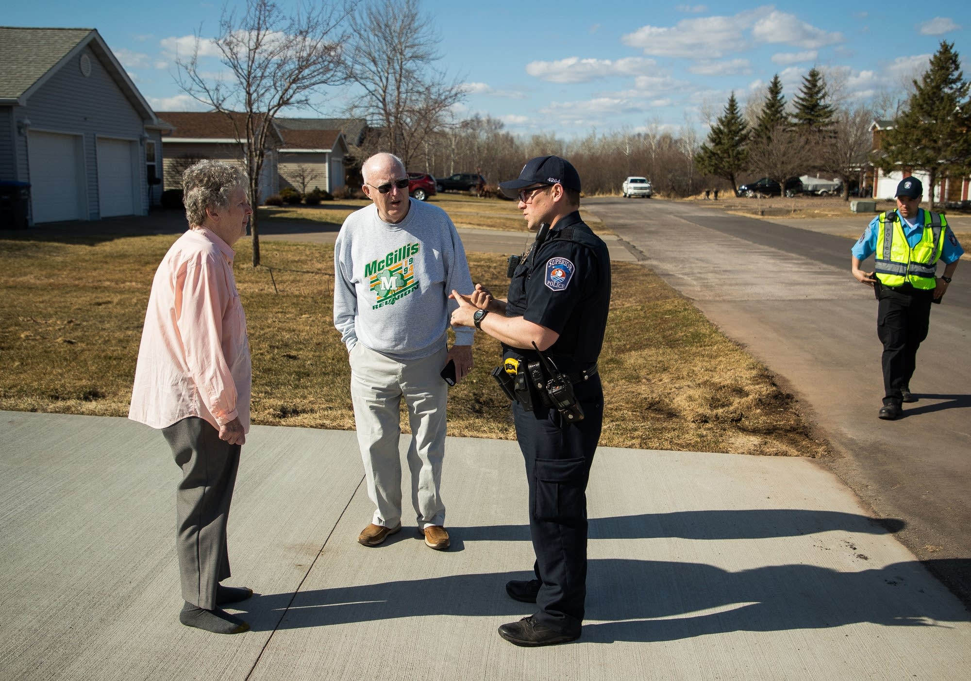 Superior officer Patrick Deignan talks to Connie Jackson and Gene McGillis.