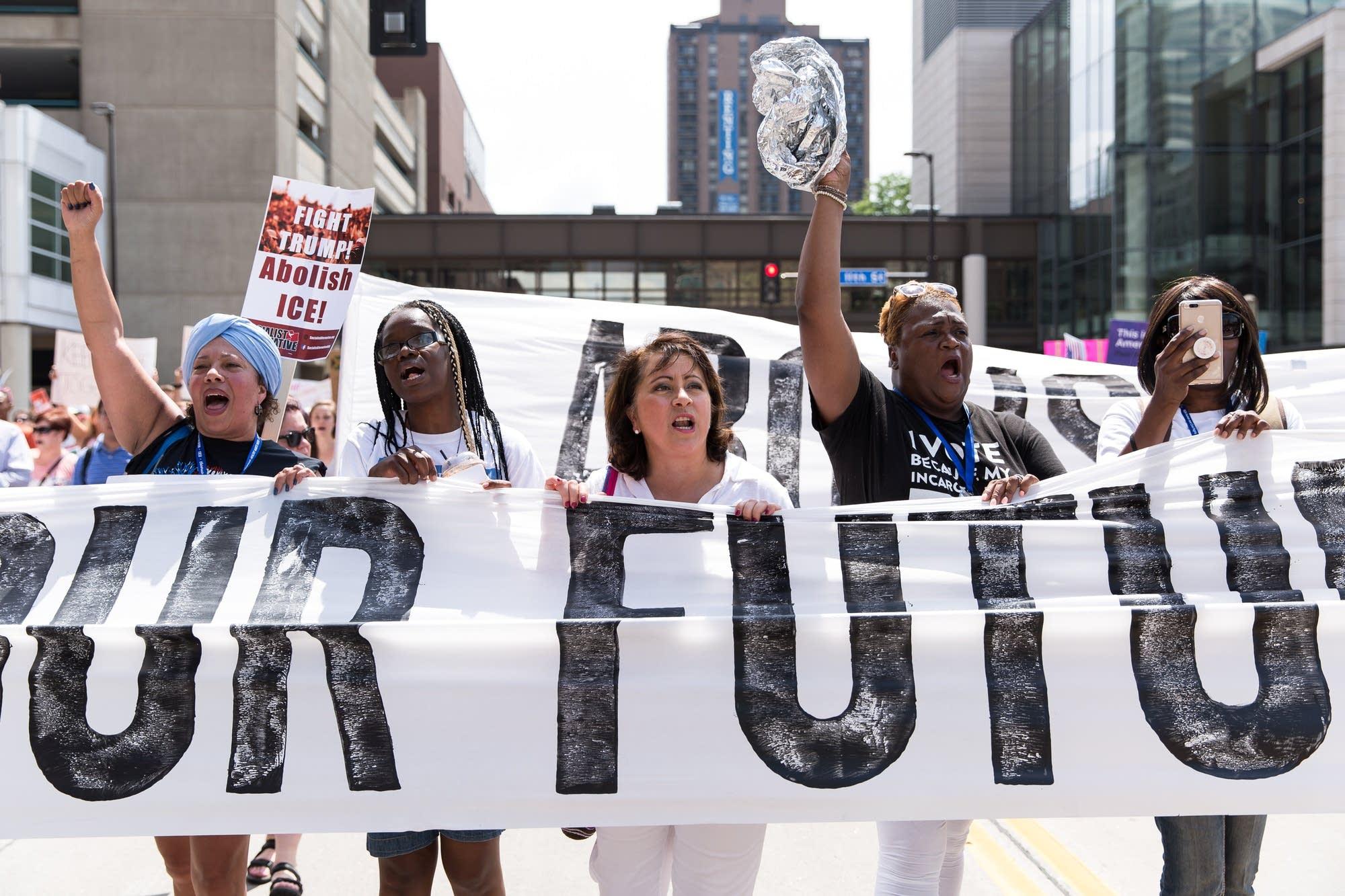 State Senator Patricia Torres-Ray marches through downtown Minneapolis.