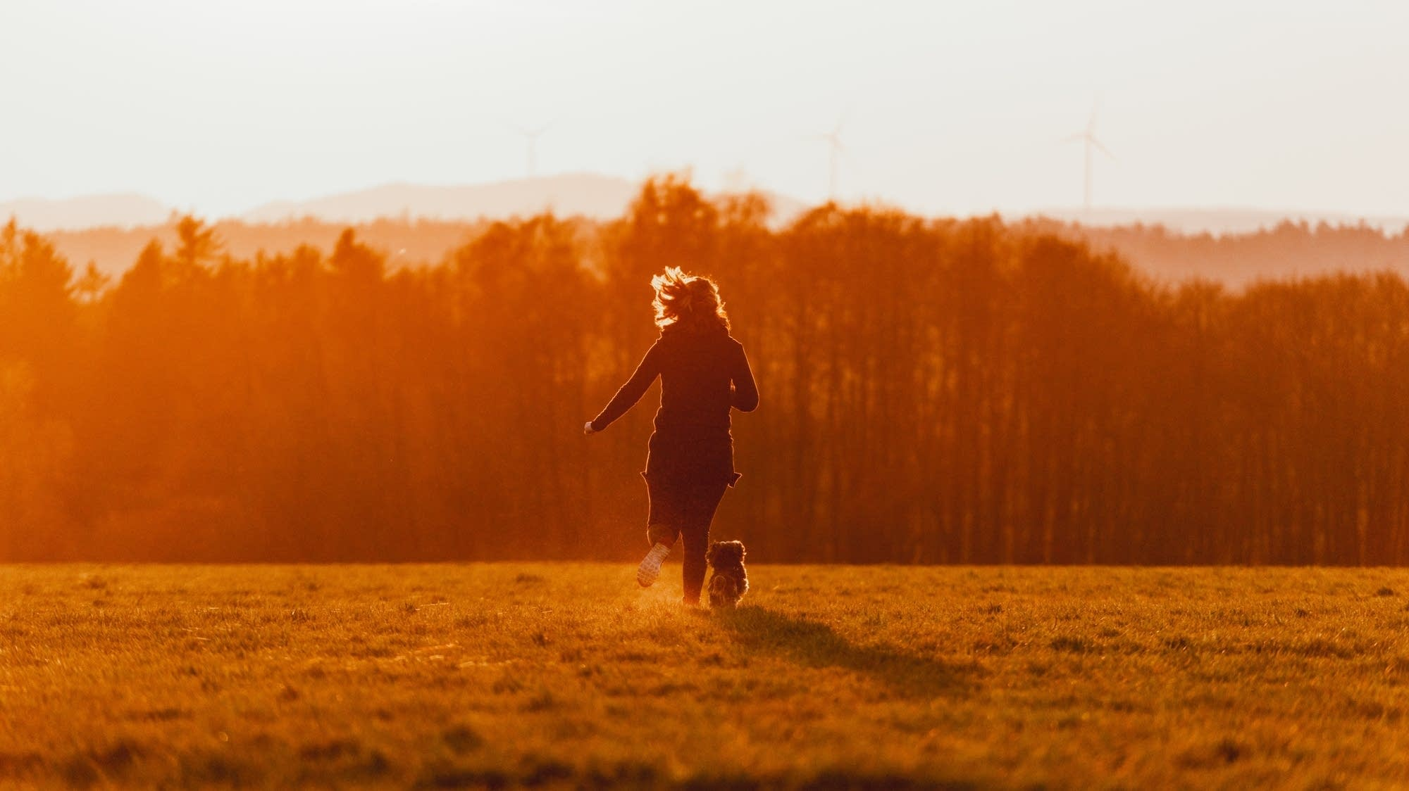 Woman and dog running