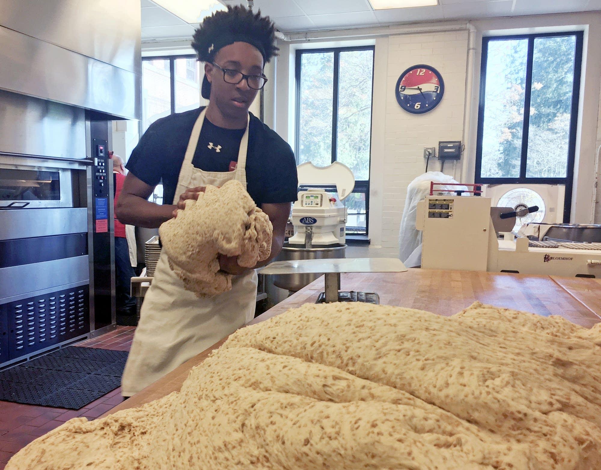 Freshman Aaryn DuBose bakes Johnnie Bread at St. John's University.