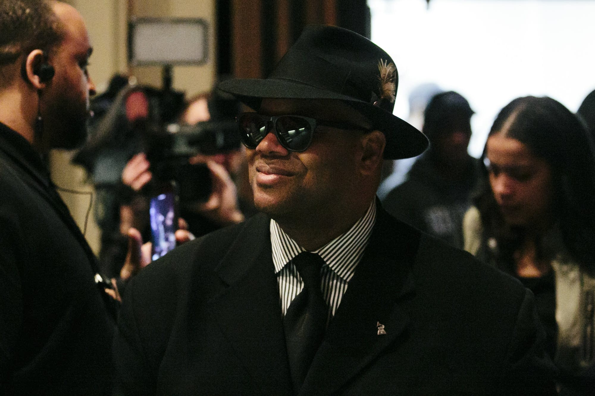 Jimmy Jam enters the North High School auditorium