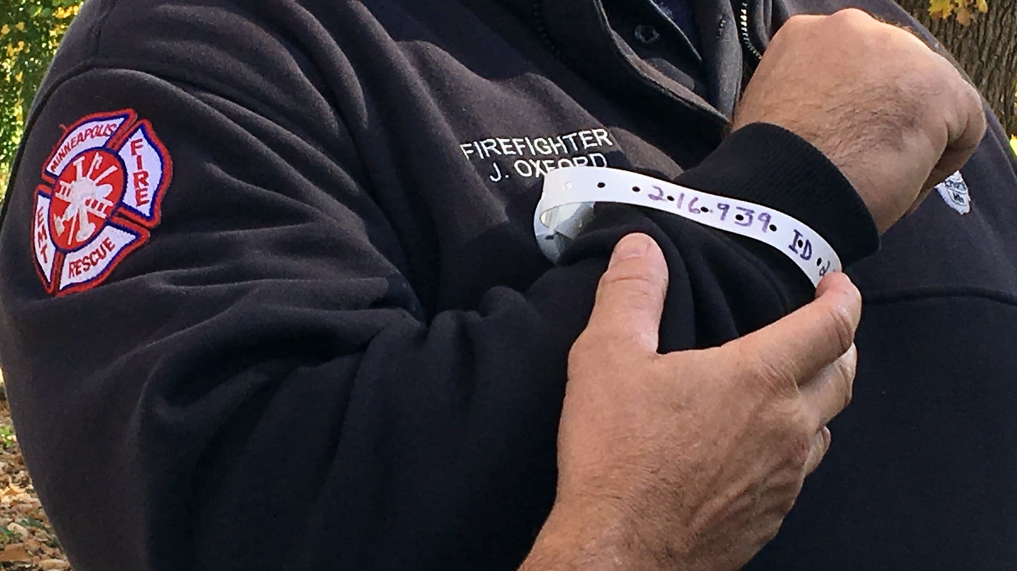 Firefighter Jason Oxford wears a locator bracelet
