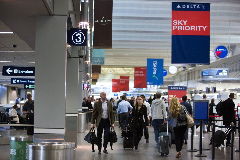 Travelers at Minneapolis-Saint Paul Intl Airport