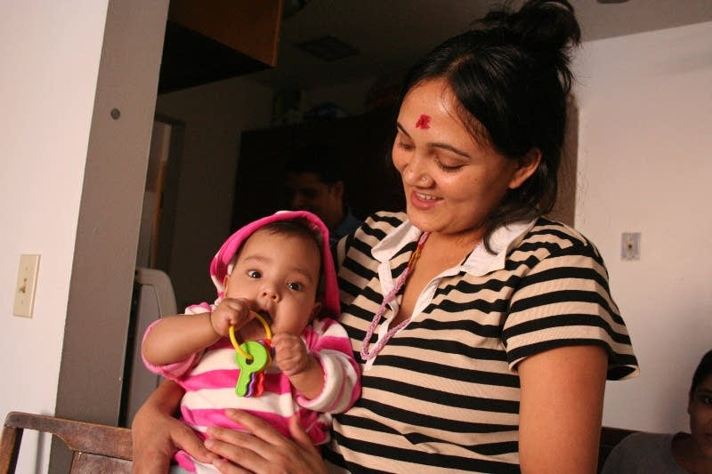 Phul Maya Khatiwada holds her daughter